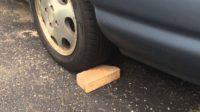 CMH mazda Menlyn- Brick under a tyre