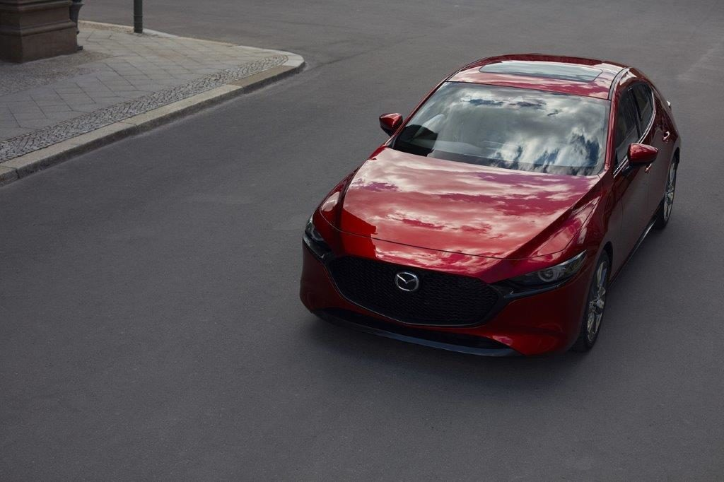 CMH Mazd- New Mazda 3 red hatch